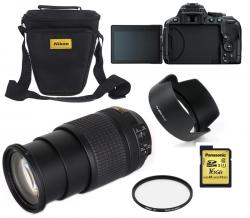 Nikon D5300 DSLR with 140mm lense and accessories