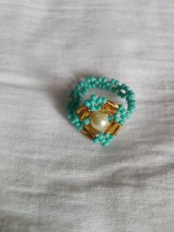 Diamond shaped teal green coloured ring