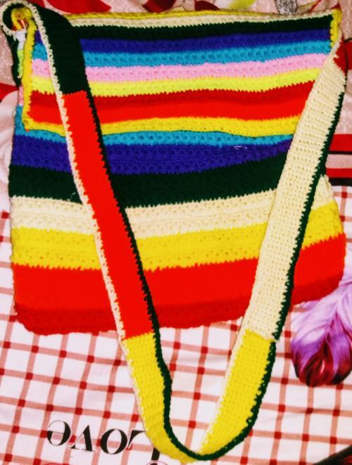 rainbow coloured crocheted side bag